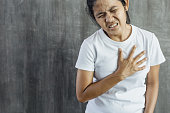 istock young woman has chest pain 1273331510