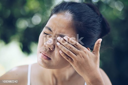 istock young woman has pain in the eye 1032682242