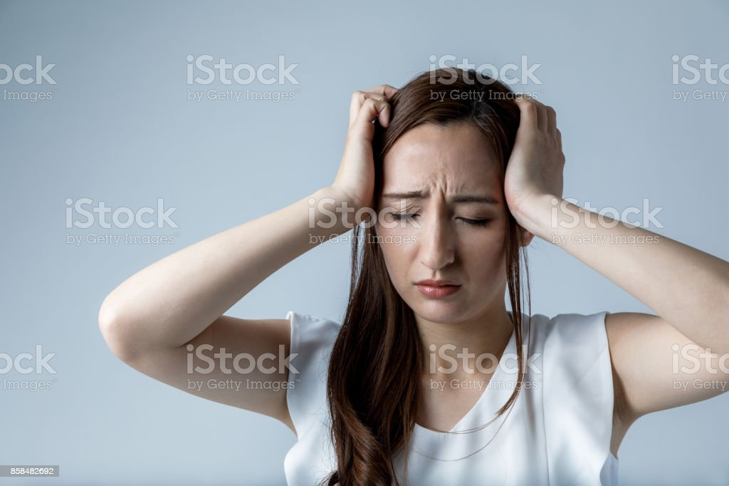 young woman have a headache stock photo