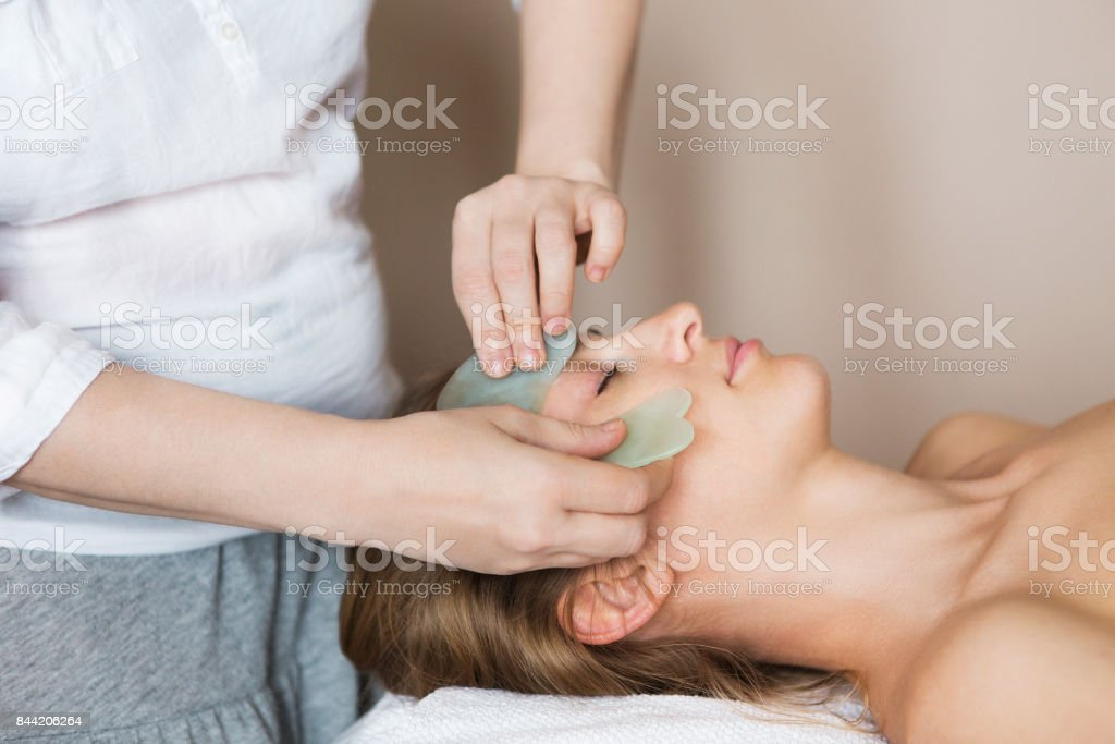 Young woman have face treatment at beauty clinic stock photo