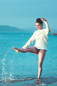 Young woman have fun on the beach and feel the freedom alone