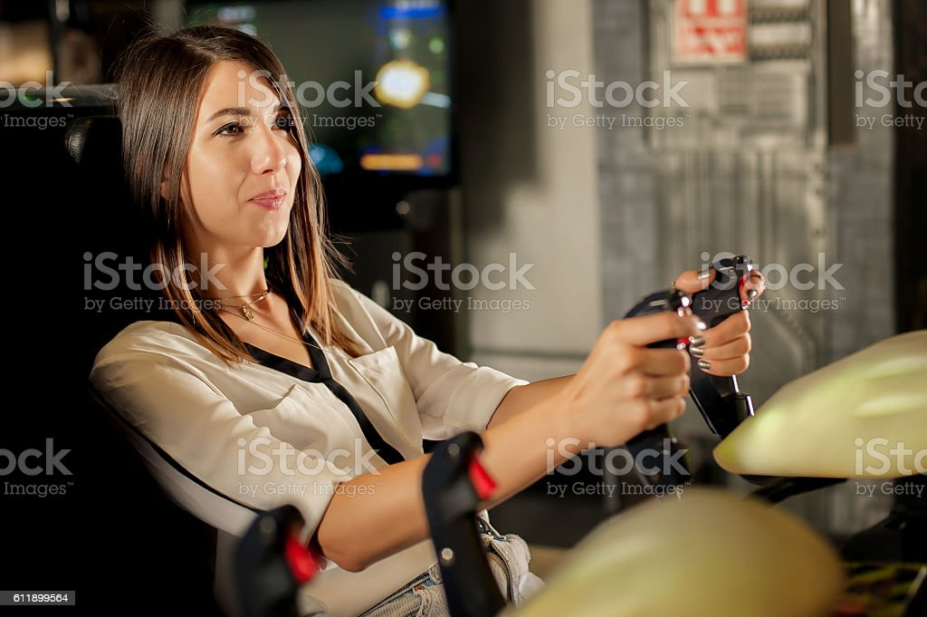 Young woman have fun on the game room stock photo