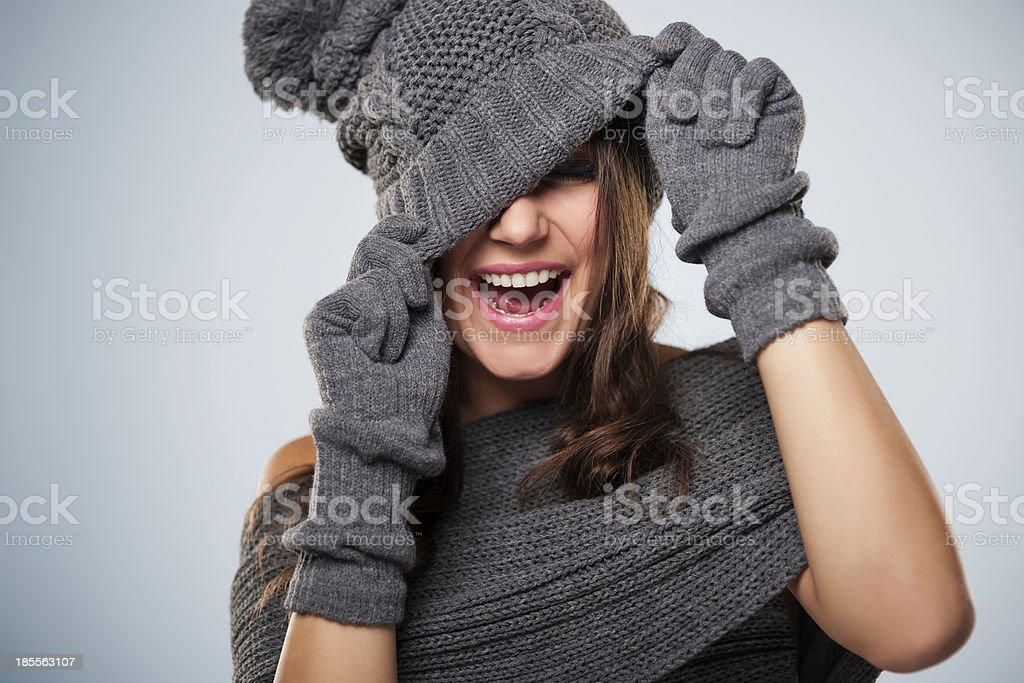 Young woman have fun with winter clothes stock photo