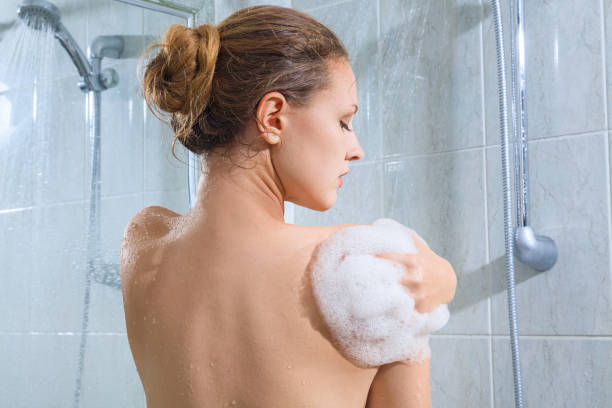 Young woman have shower