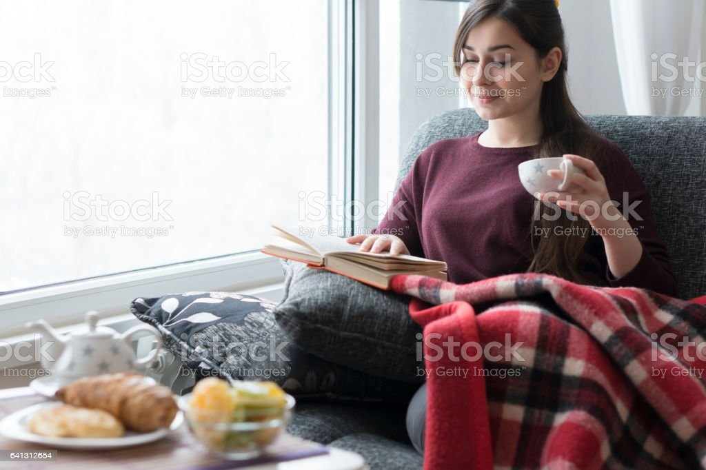 Young woman having a breakfast at home stock photo