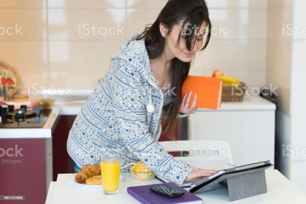 Young woman having a breakfast at home royalty-free stock photo
