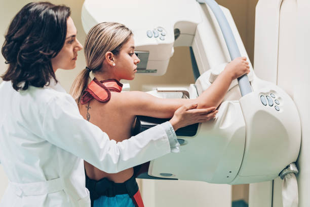 Young woman having a breast scan stock photo