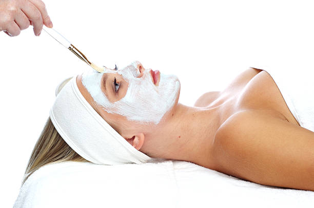 Young woman having a facial treatment at a spa stock photo