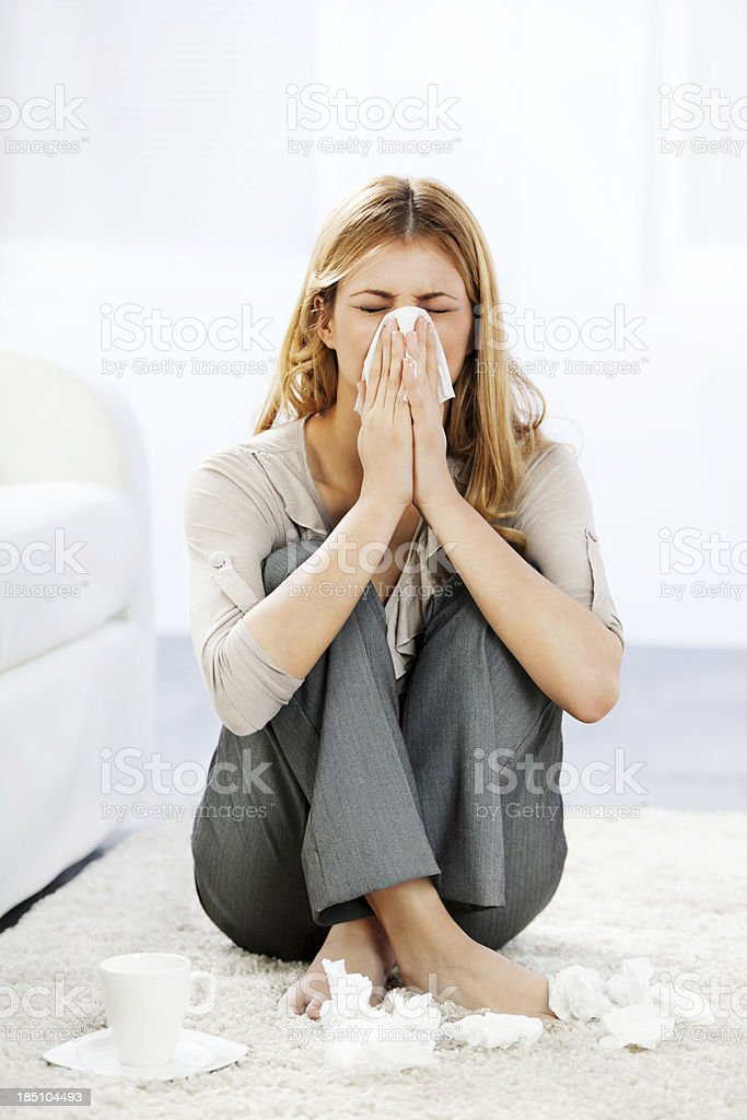 Young woman having a flu. stock photo