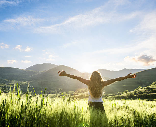 young woman having a fresh morning outdoor - arms outstretched stock photos and pictures
