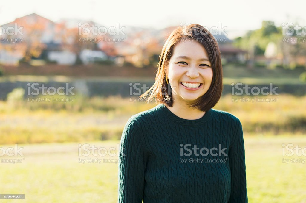 Young woman having a good time in outdoors stock photo
