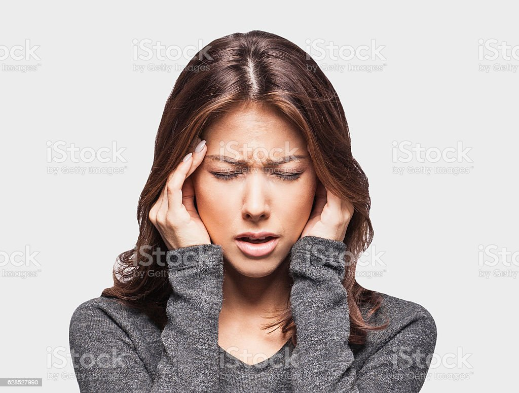 Young woman having a headache stock photo