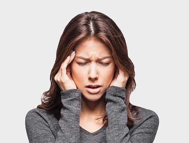 Young woman having a headache stock photo
