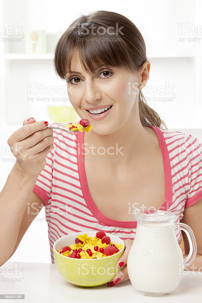 Young woman having a healthy breakfast at home royalty-free stock photo