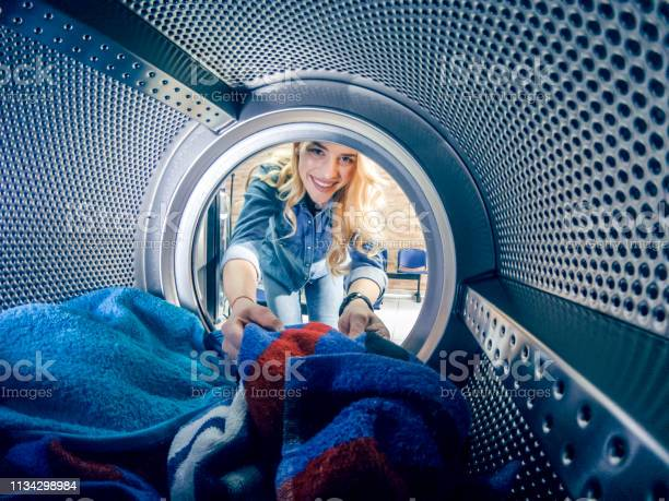 Young woman having a laundry day picture id1134298984?b=1&k=6&m=1134298984&s=612x612&h=sj a7gbwek zfbawsnjyyh q4ngf2t1dpautitqc1 0=