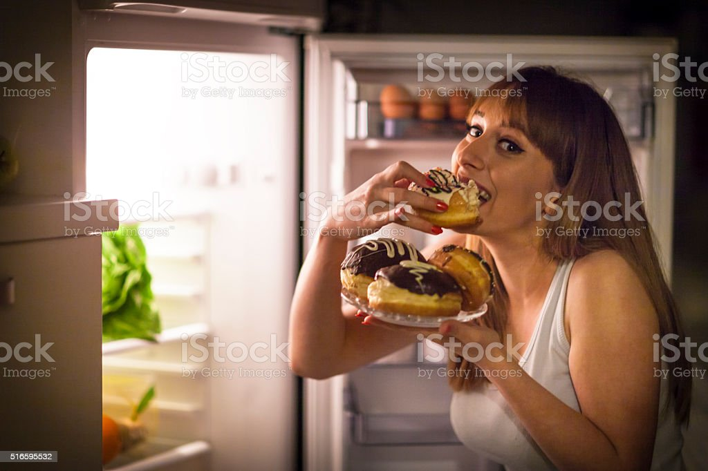 Close up image of a young woman with eating disorder, having a...