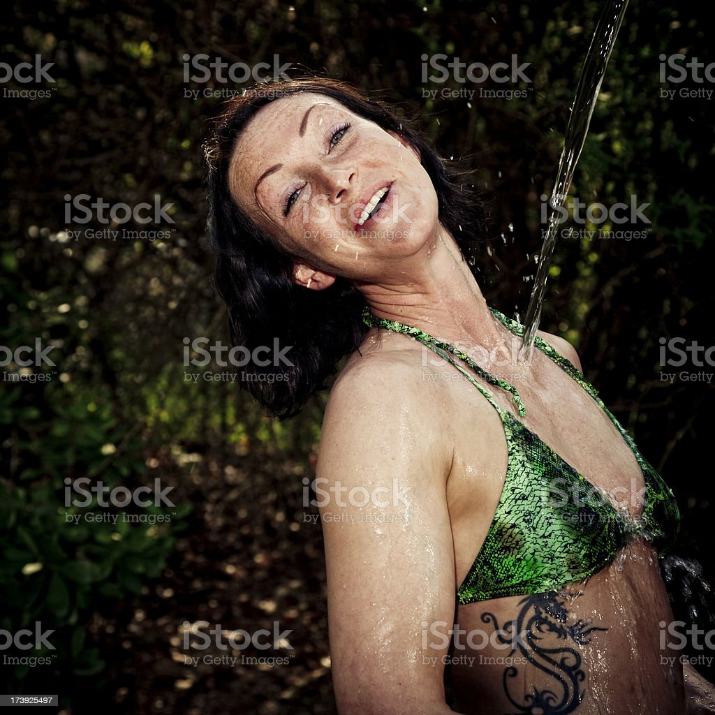 young woman having a refreshment royalty-free stock photo