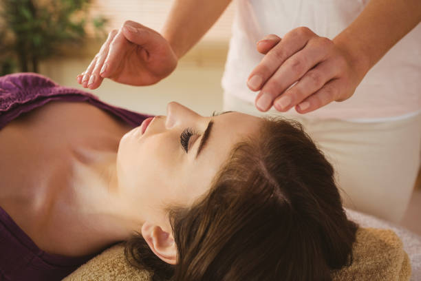 Young woman having a reiki treatment picture id670169566?b=1&k=6&m=670169566&s=612x612&w=0&h=x hvpoe5q6ko9zw3thu2gr2rjkevoscwggge9nf7p8g=