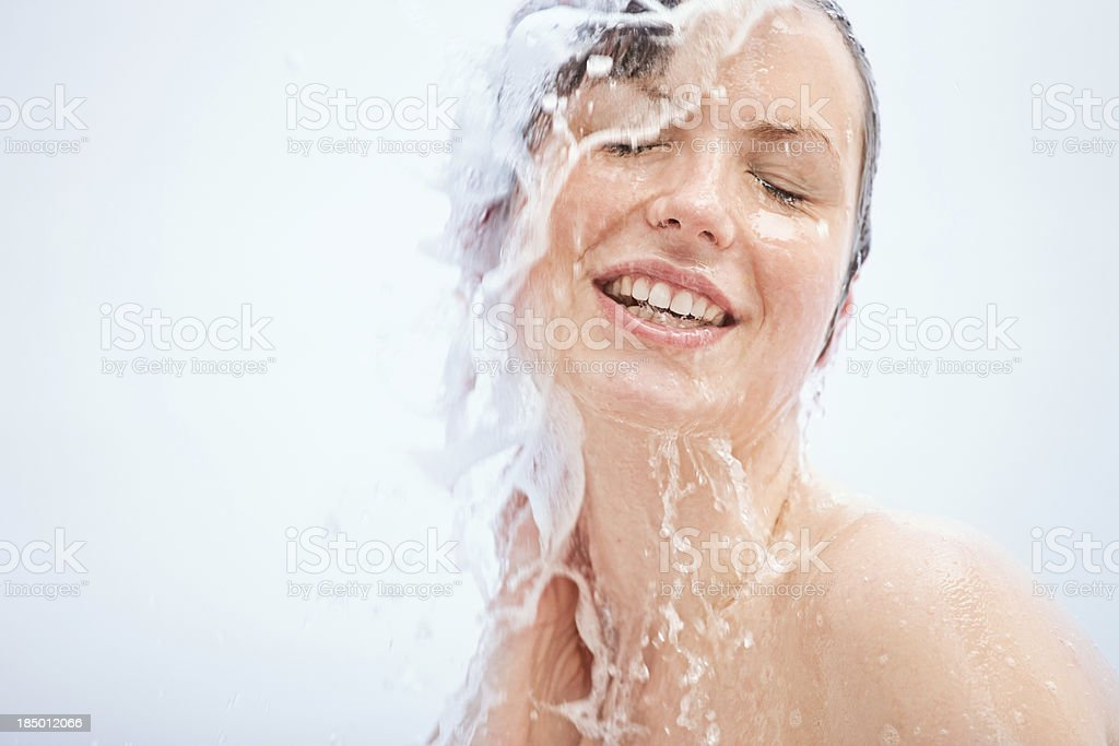 young woman having a shower stock photo