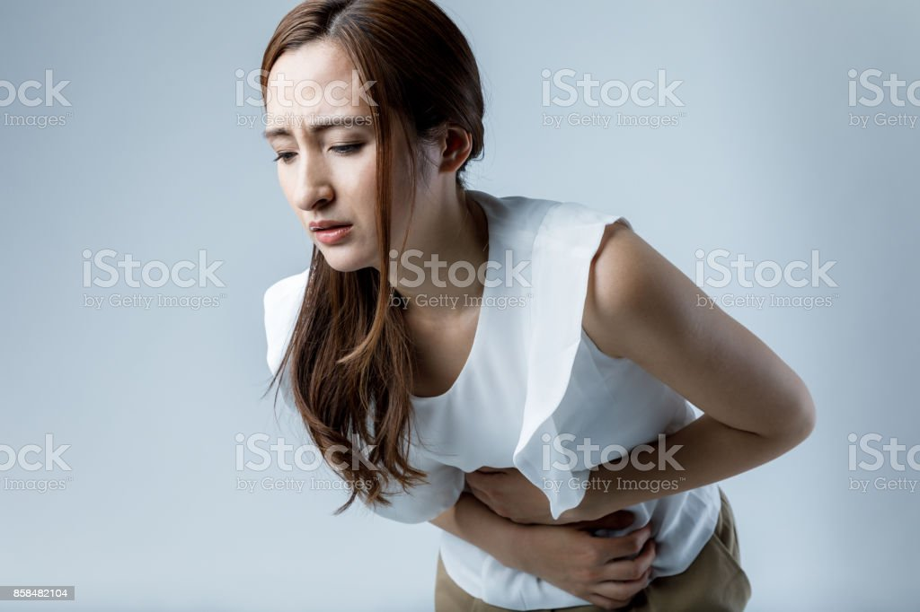 young woman having a stomachache stock photo