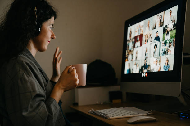 Young woman having a video call with her colleagues stock photo