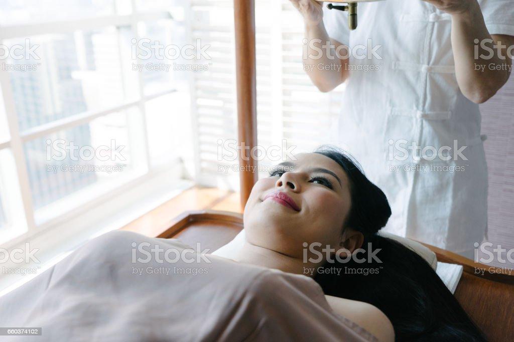 Young woman having ayurveda spa massage stock photo