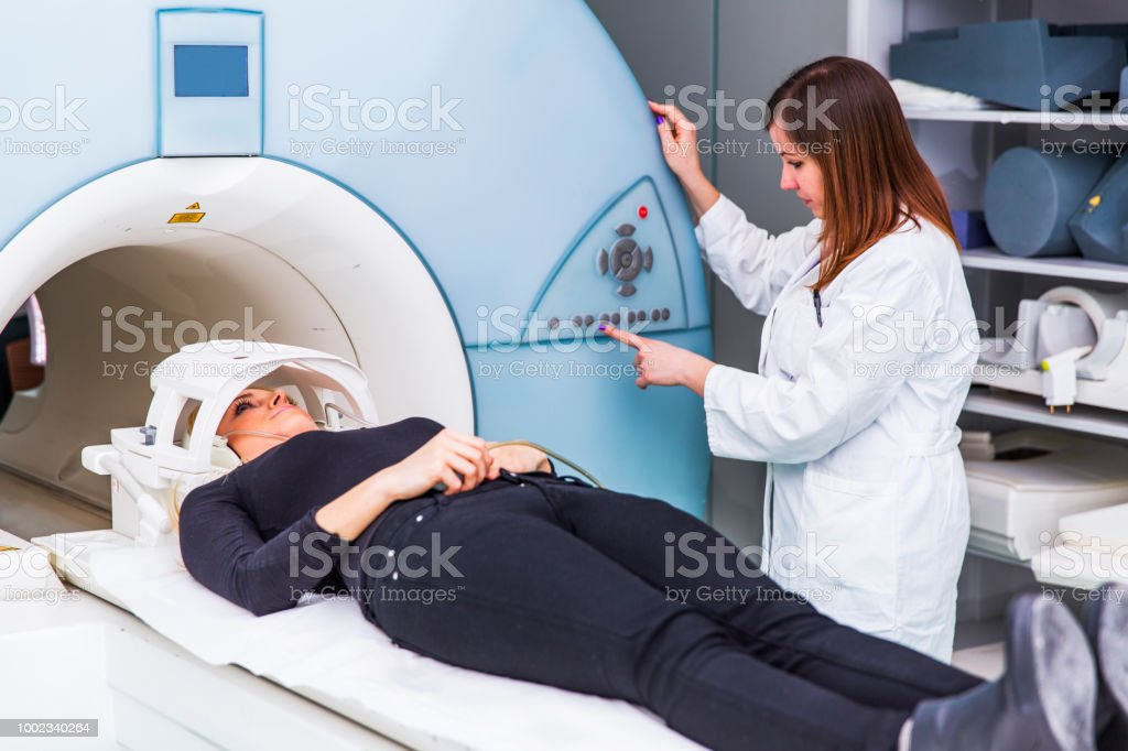 Young woman having CAT scan