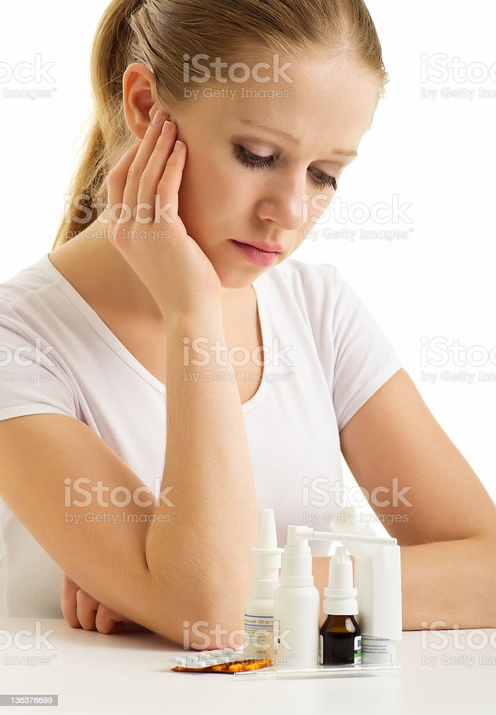 Young woman having flu takes pills royalty-free stock photo