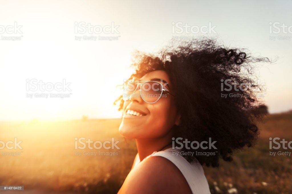 Young woman having fun at sunset stock photo