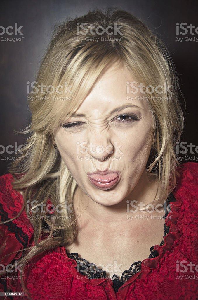 Young Woman Having Fun Making A Face stock photo