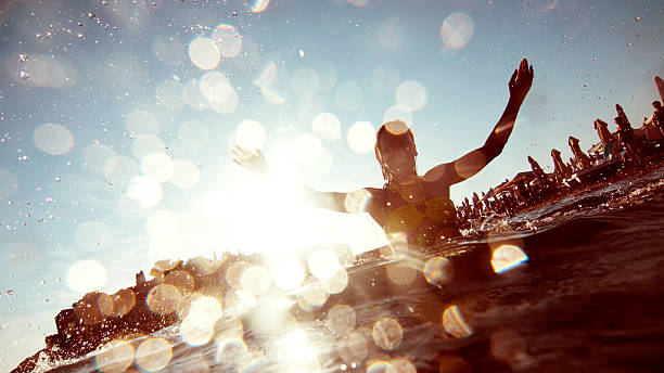 Young woman having fun Silhouette of young woman splashing the water shallow stock pictures, royalty-free photos & images