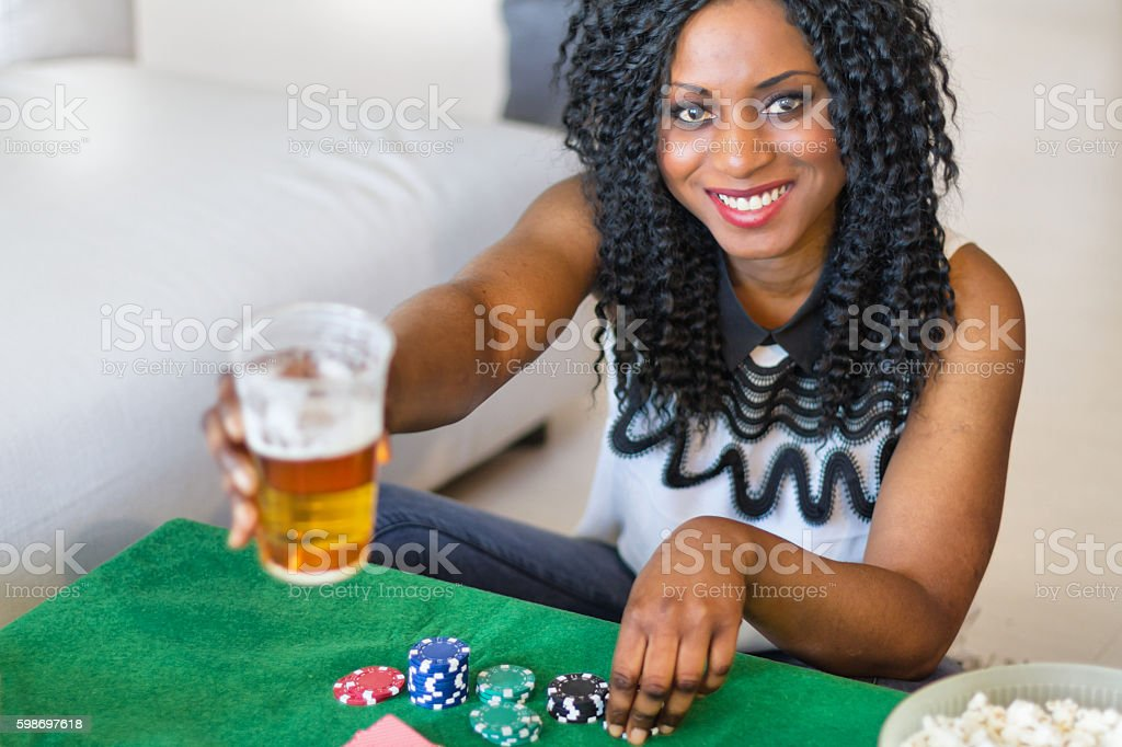 Young woman having fun playing with her friends stock photo