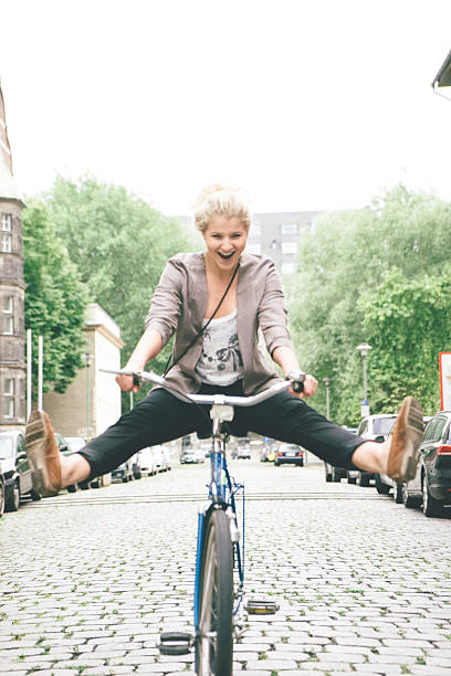 Young Woman Having Fun Riding Her Bike In City Streets stock photo