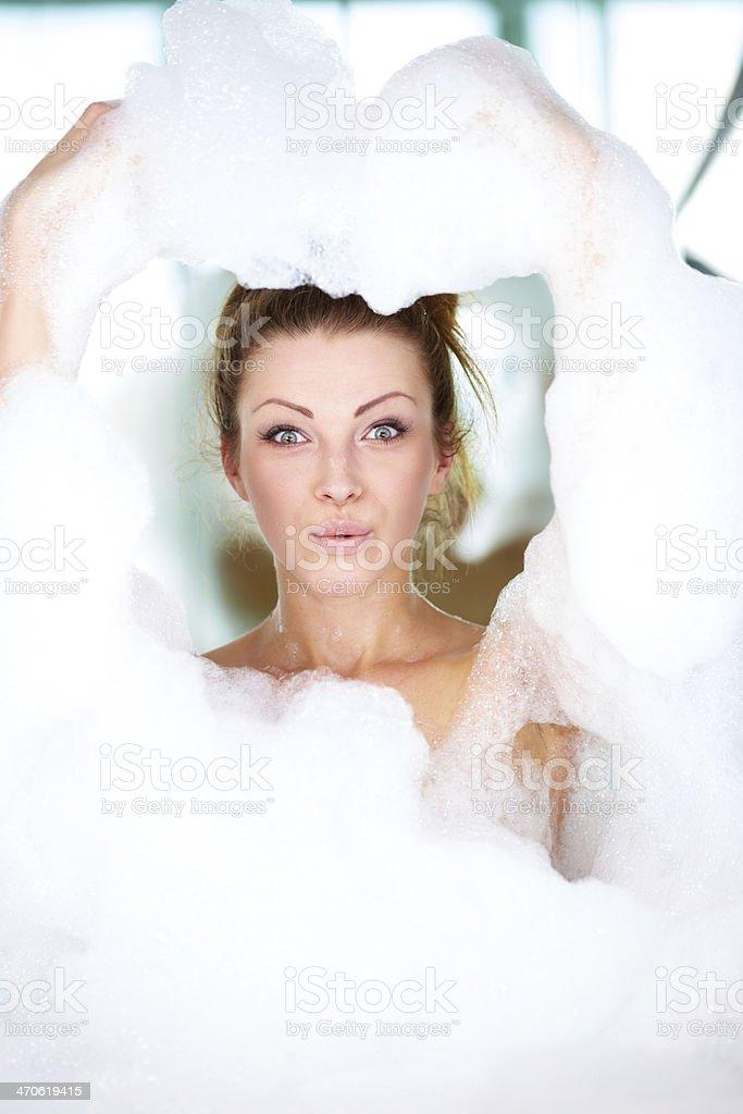 Young Woman Having Fun With Foam Bath In The Tub Stock Photo