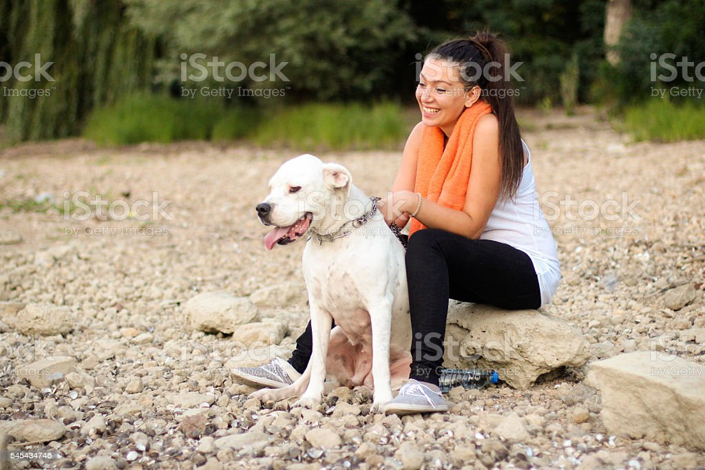 Young woman having fun with her dog stock photo