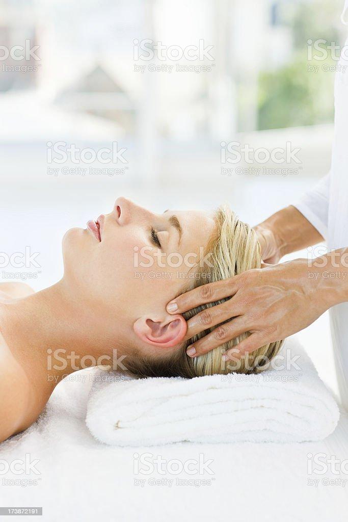 Young woman having  head massage at spa royalty-free stock photo
