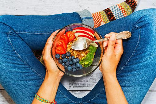 istock Young woman having healthy breakfast 853924354
