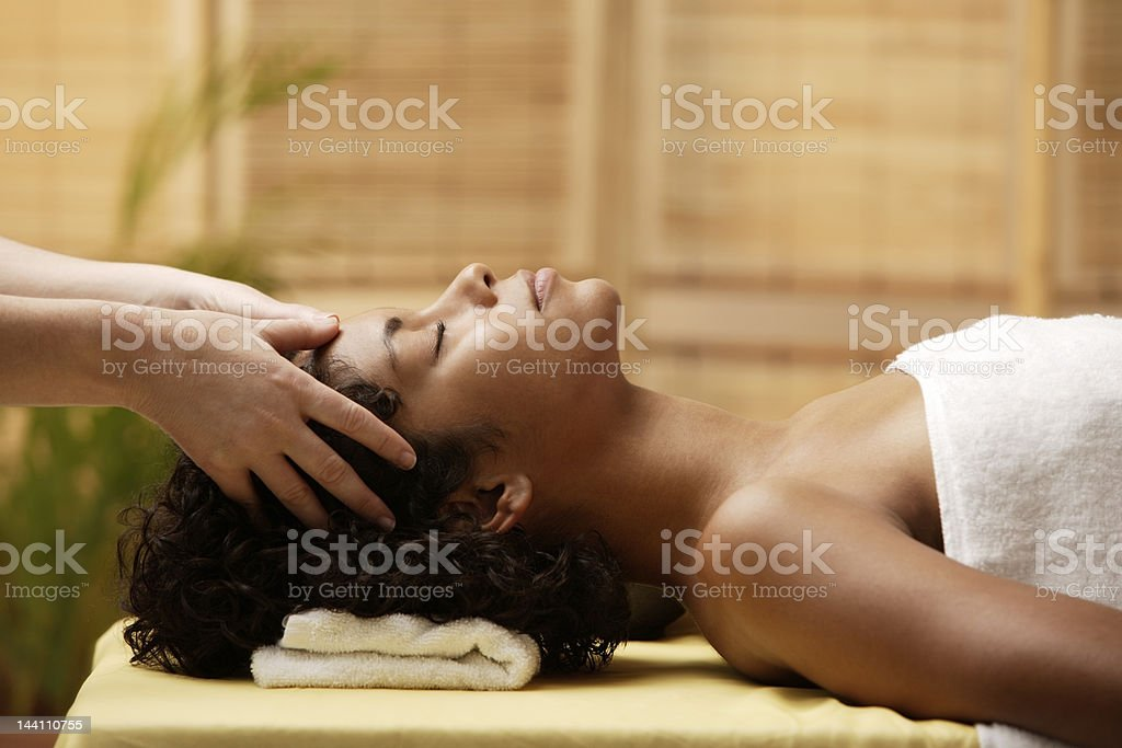 Young woman having her head massaged royalty-free stock photo