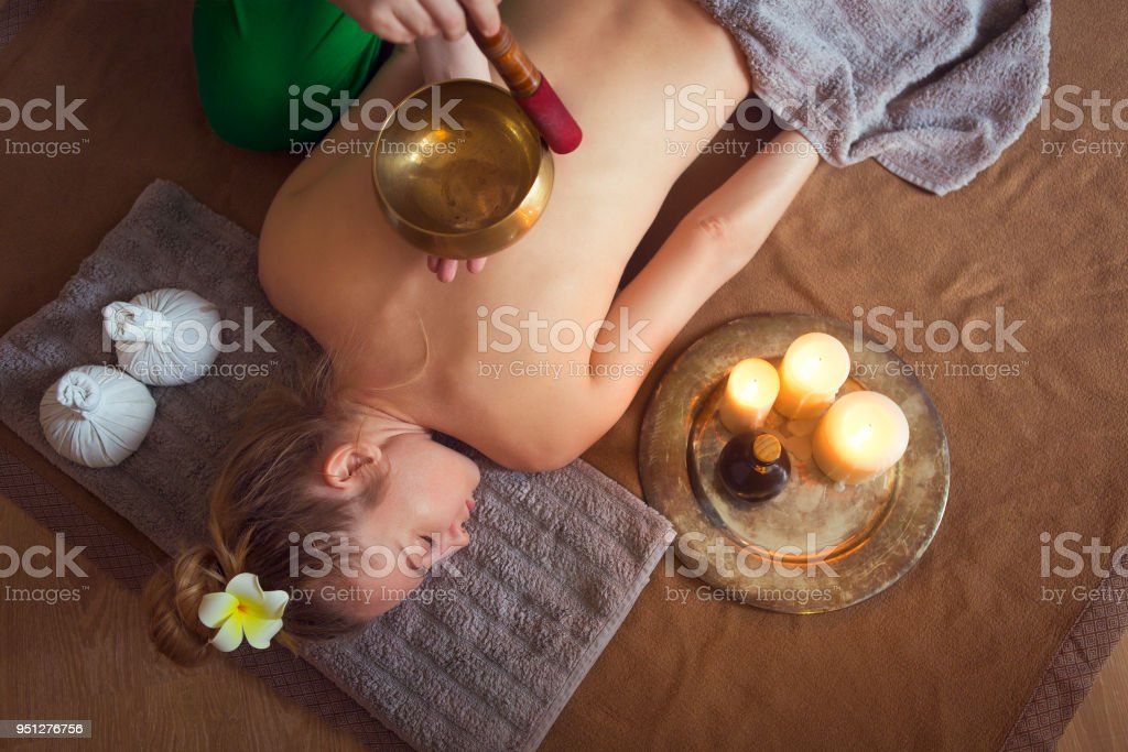 Young woman having massage treatment stock photo