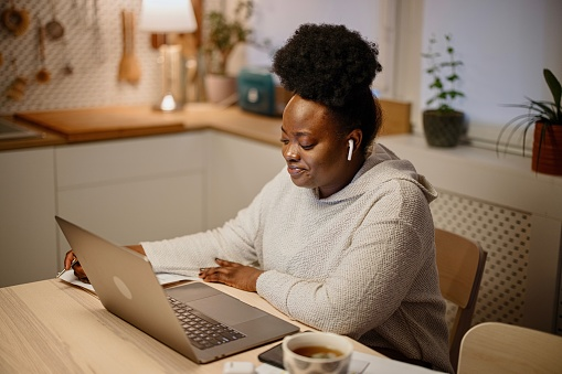 Young African woman using telemedicine to seek mental health services in an increasingly virtual world. Communicates remotely