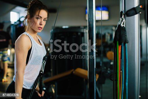 619088796 istock photo Young woman having training in gym 874604326