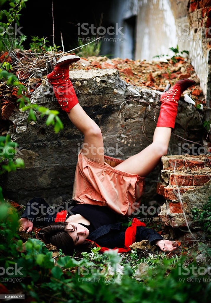 Young Woman Head Over Heels After Falling Outside royalty-free stock photo