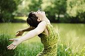 Young woman, her face upward, enjoying the sun