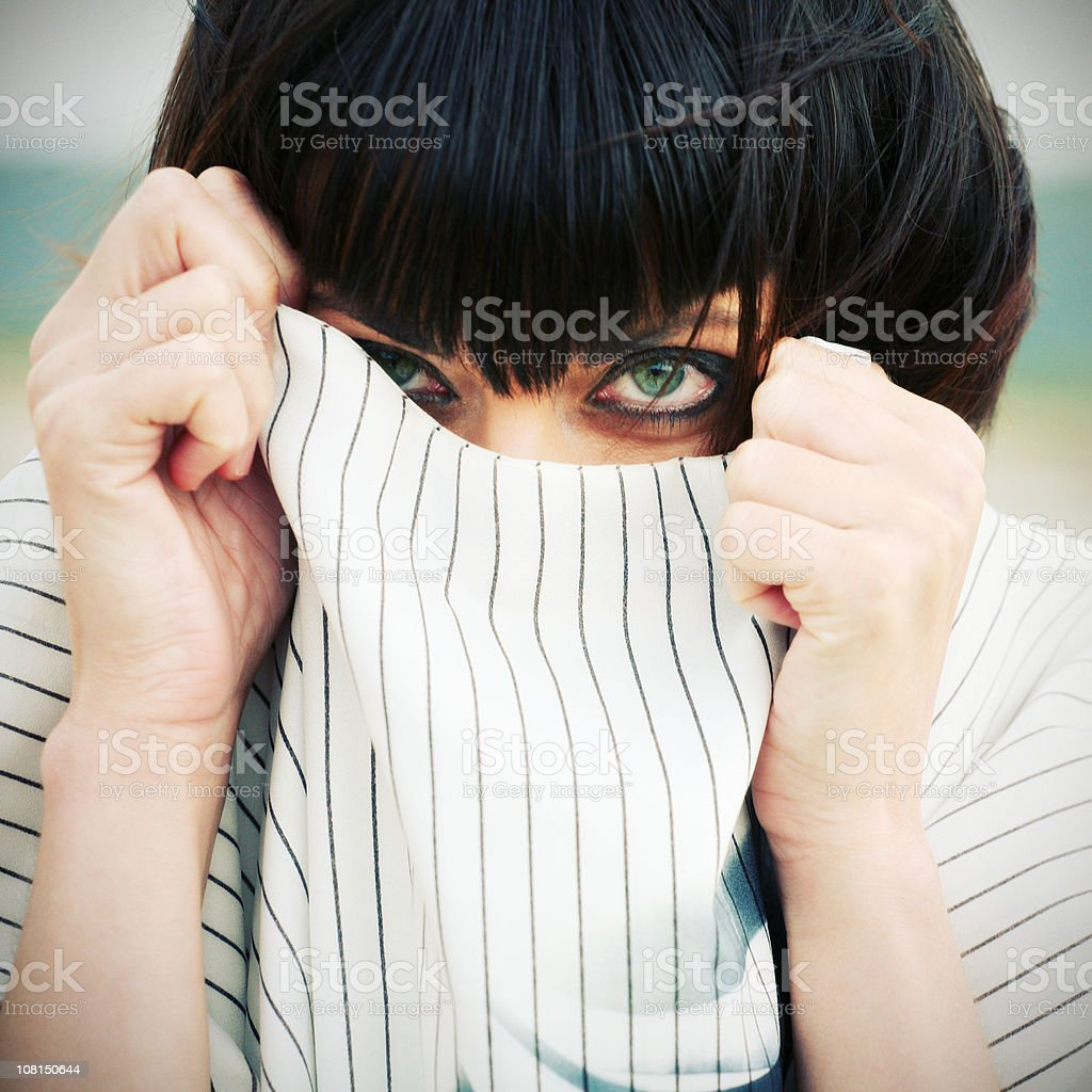 Young Woman Hiding in Shirt Collar royalty-free stock photo