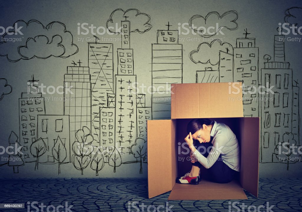 young woman hiding in the box on skyscraper city background stock photo