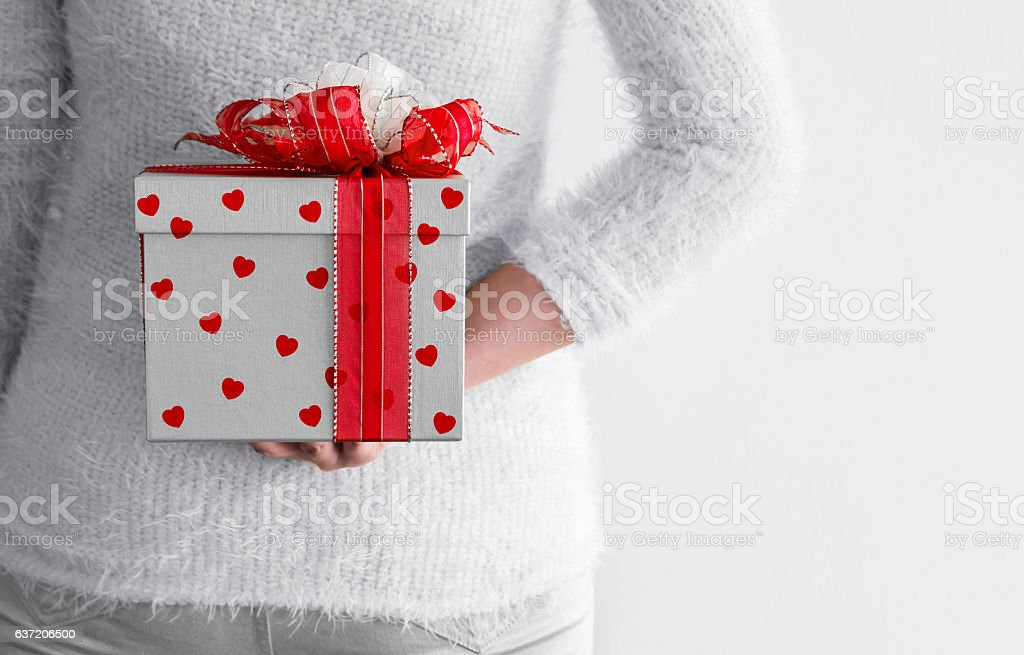 Young Woman Hiding Silver Gift Box Behind Her Back Stock Photo Download Image Now