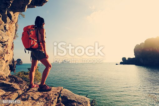 istock young woman hiker enjoy the view on sunset seaside 531991412