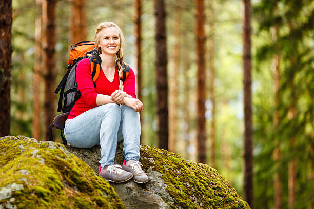 Young woman hiker on a break stock photo