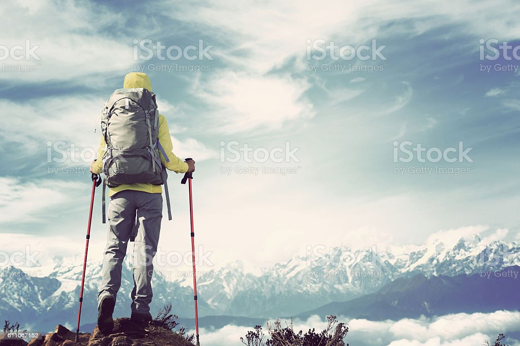 young woman hiker stand face the beautiful snow mountain stock photo