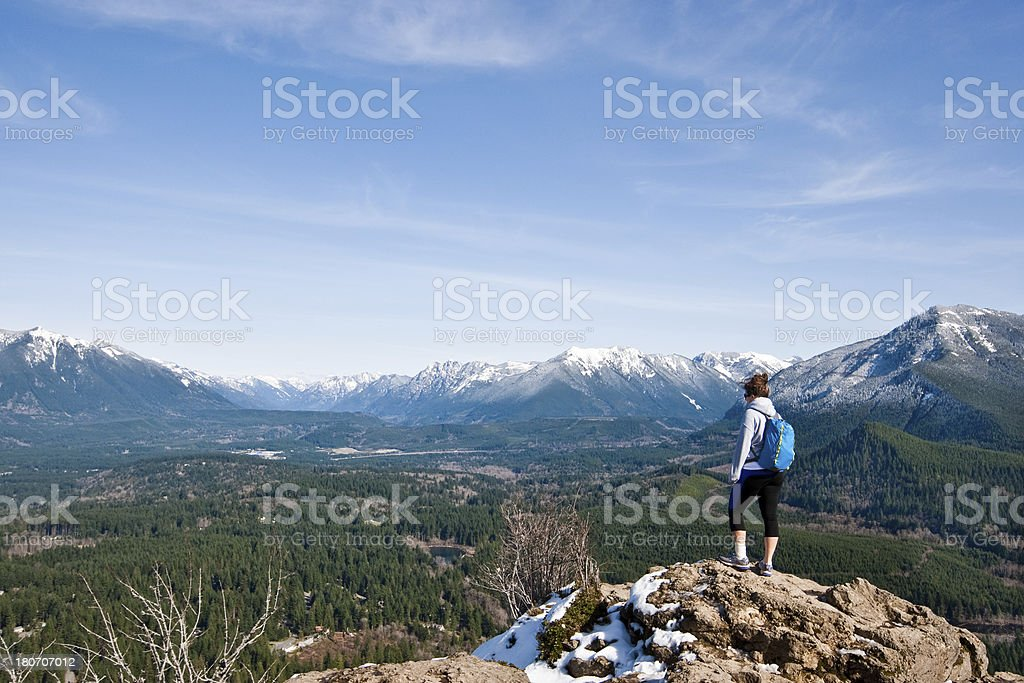 Young Woman Hiker Standing on a Rock Summit stock photo